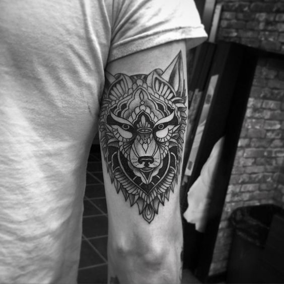 Artistically Rendered Geometric Wolf Bicep Tattoo