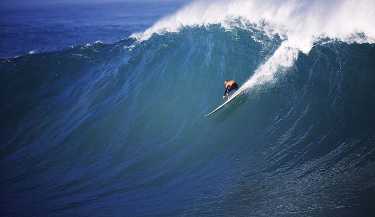 Kelly Slater with a perfect 10 at Waimea. <3 photo by Lucia Griggi
