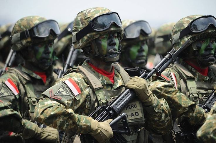 Indonesia Military march during The 69th Republic of Indonesia Military Anniversary on October 7, 2014 in Surabaya, Indonesia.
