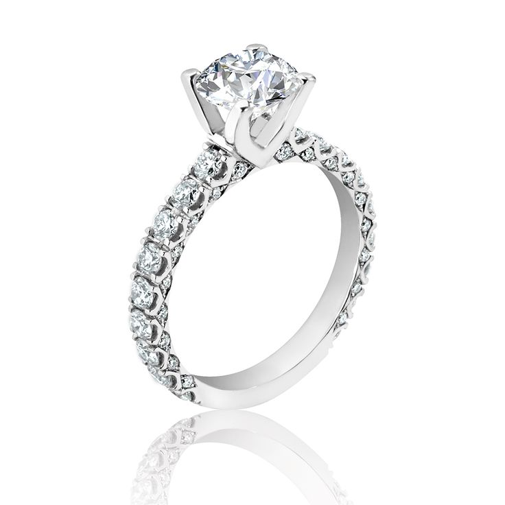 A distinctive band of richly set brilliant diamonds encircles our signature Amira solitaire. This splendid setting offers luxury at its finest.