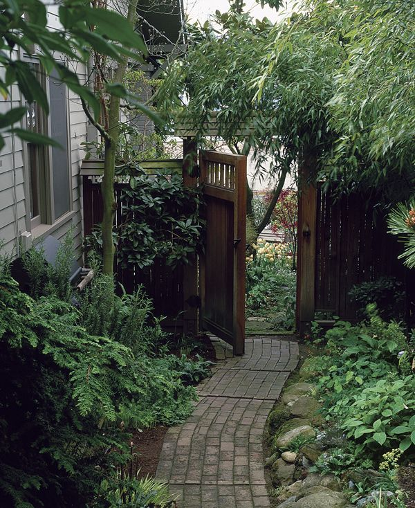 side yard ideas   He varied the plantings and hardscaping materials to give each one a ...