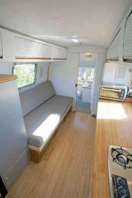 What a cool, elegant space. (The interior of a restored Airstream trailer from the 1970s)