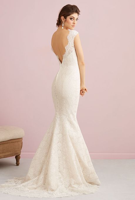 Brides: Allure Romance . This lovely cotton lace gown proves that simple and chic bridal style is just as powerful as one bejeweled and glitzy.  See Allure Bridals on YouTube