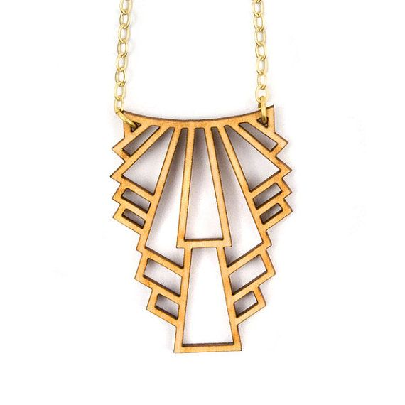 Laser cut necklace in birch wood. Inspired by art deco style and long enough to be layered with shorter necklaces, its also beautiful on its own. Go