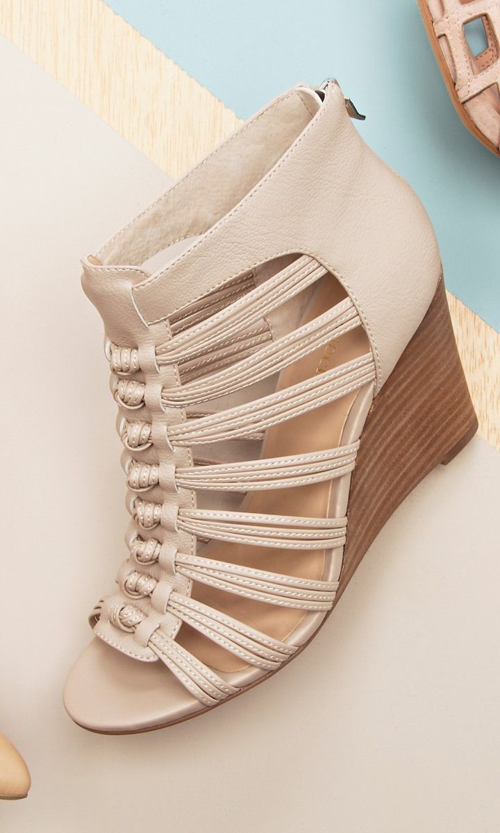 Wedge sandals with ultra-detailed knotted straps, open toe, stacked heel and easy back zipper at heel.