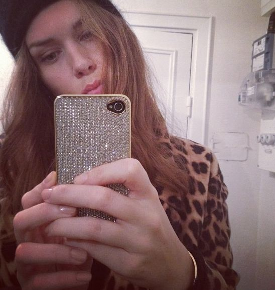 Caroline Blomst with the Gold Swarovski  iPhone Case.  Photo Courtesy of Caroline Blomst.