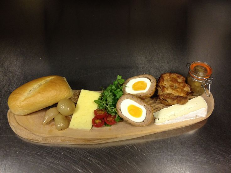 Ploughman's lunch with homemade pork pie, scotch egg, piccalilli and pickled onions