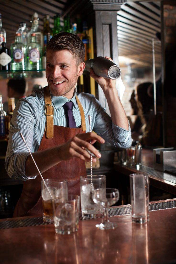 This bartender is so expert that he's able to prepare several different cocktails at the same time!