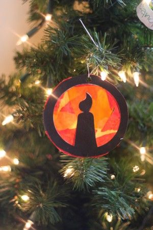 """amazing 24-day """"curriculum"""" of sorts to use every day in December. Every single day revolves around a story of Christ's birth or his ultimate purpose for coming to Earth. There is an ornament craft for each day that your child creates. Here is an example of Day 1: Jesus came to bring light to the world."""