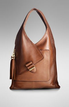 So Classic and Chic!!! Derek Lam bag.  I love the wrap around on the handle to the pocket flap!  Brilliant.