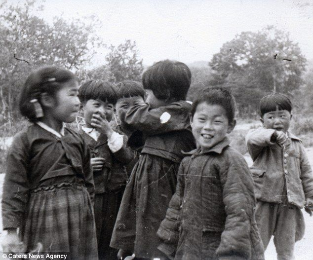 Childhood: The photographer captured a group of giggling children in North Korea in the late 1950s