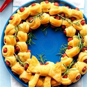Ring of Piggies Recipe -This charming plate of piggies looks like a holiday wreath when I drape fresh rosemary in the center. It's a cute display for merry get-togethers. Dunk into brown mustard. —Julie Peterson, Crofton, MD