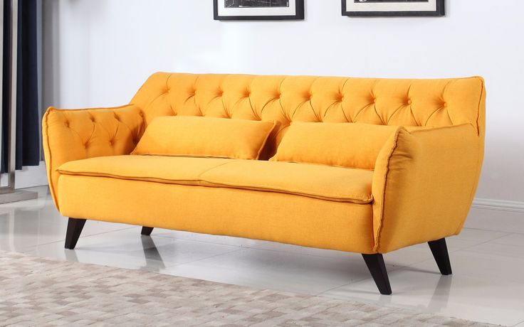 Mid century modern style living room accent chair with a tufted design, includes 2 decorative pillow and dark wooden legs to complete the look. Soft linen fabric upholstery with raw exposed stitched e