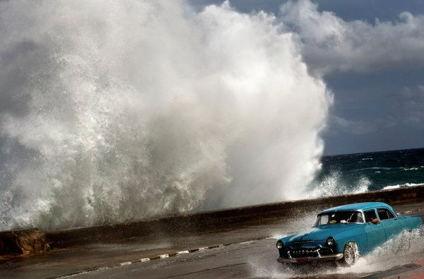 A driver in Havana, Cuba, last year during Hurricane Sandy. I thought at first it was the 1950s.