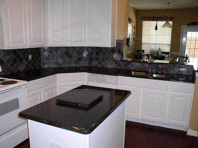 white kitchen cabinets with uba tuba granite uba tuba granite with white cabinets home 29046