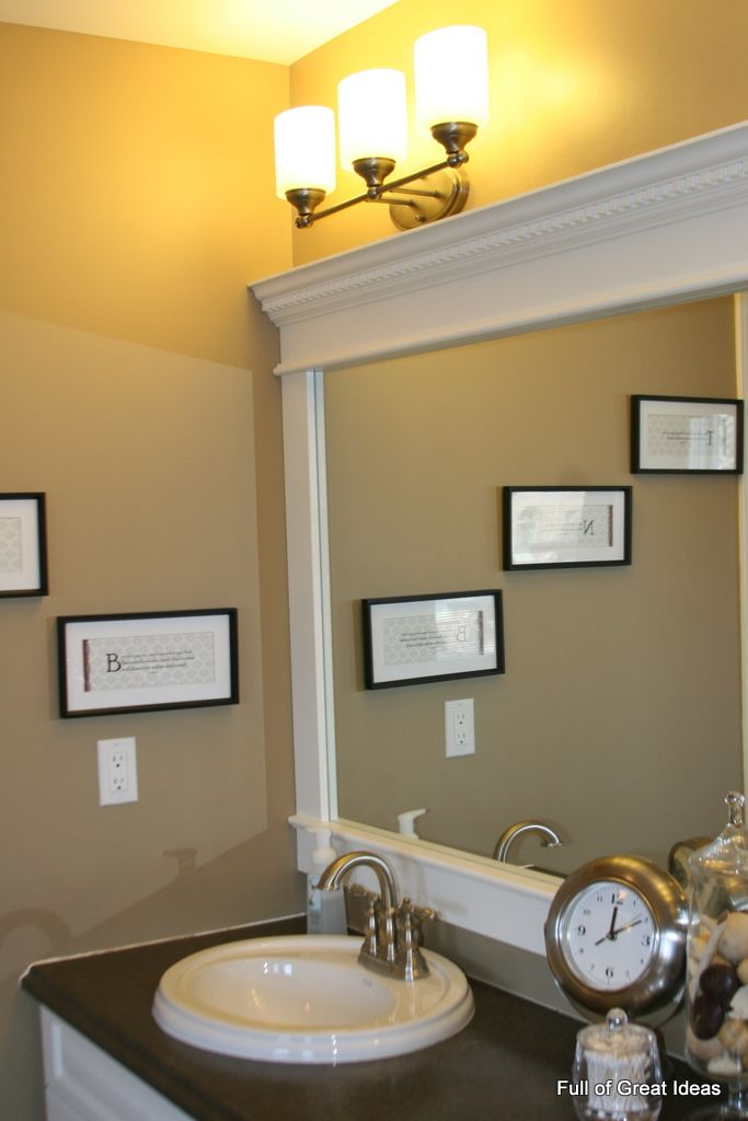 Inexpensive and easy way to upgrade your plain bathroom mirror-- use MDF trim and crown moulding to build a frame around the mirror. The Full of Great Ideas blog has DIY instructions for this clever bathroom remodeling project. @Full of Great Ideas