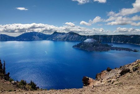 "Crater Lake Oregon, United States   ""It was unbelievably beautiful to watch the sunrise over the rim and cast its multicolored rays over the lake."""