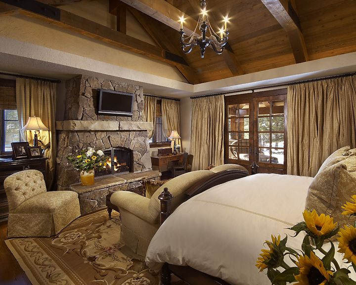 The use of soft neutrals mixed with rugged architectural elements, create a cozy master suite in this mountain home.