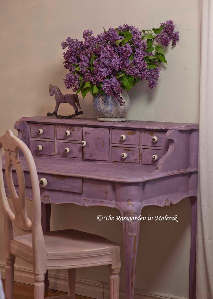 Lilacs On A Light Purple Desk With A Light Mauve Chair