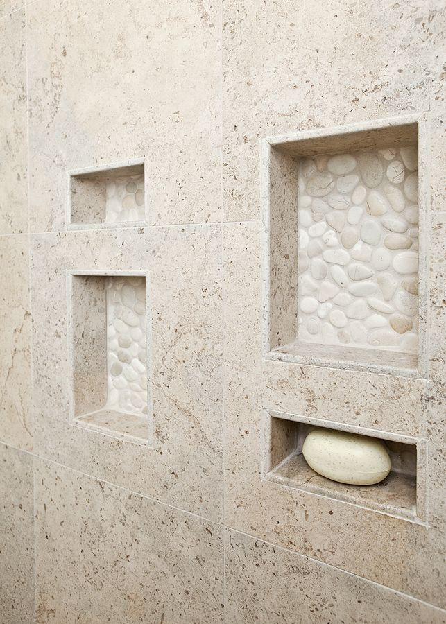 From kitchendetailsanddesign.com. Use as many natural stone tiles as you can afford! Love the white pebble tile at the back of the niches. https://www.pebbletileshop.com/products/White-Pebble-Tile.html#.VOuoMvnF-1U