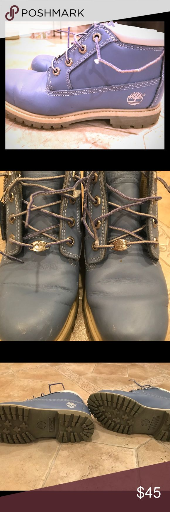 Woman's timberland waterproof boots size 8 1/2 Woman's blue waterproof ankle timberland boots size 8 1/2. I only wore about a dozen times. *Please look through pics. Front of shoes have some white scrapes on them* otherwise excellent condition. Timberland Shoes Ankle Boots & Booties