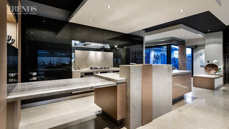 Galley kitchen design merges with large living space and links to ...