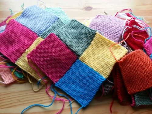 I've just started to sew all my little squares together to make bigger squares for my hand knitted blanket.