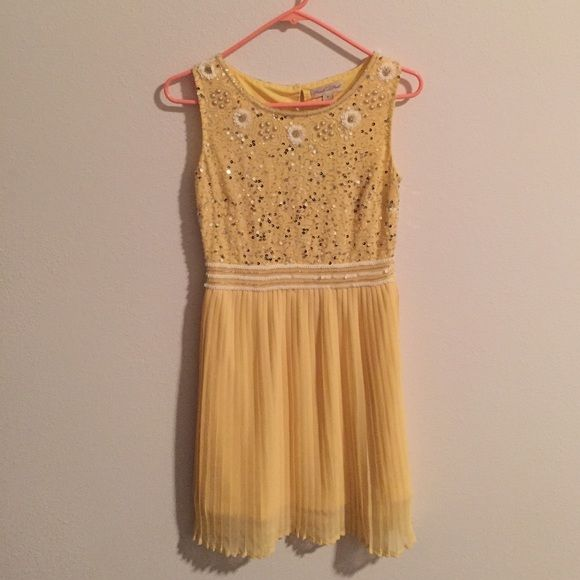 Frock and Frill yellow dress with sequin bodice Stunning UK brand Frock and Frill dress in lemon yellow, with gorgeous sequin bodice. Worn only once for a special occasion and dry cleaned. In like-new condition. Frock and Frill Dresses