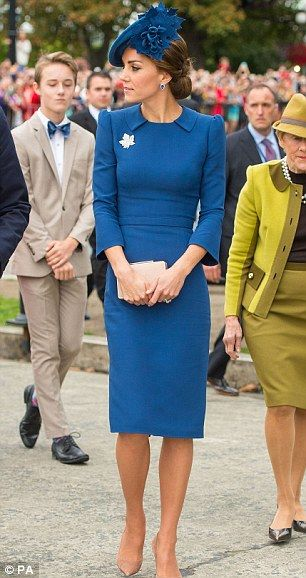 Kate stepped off the plane looking elegant in a blue Jenny Packham dress estimated to have cost at least £1,000 with a Locke and Co hat