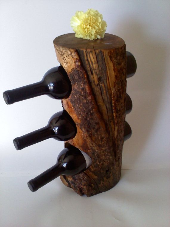Reclaimed Bristlecone Pine Wine Rack by AspenBottleHolders on Etsy.  BUT I SAY....make one yourself!