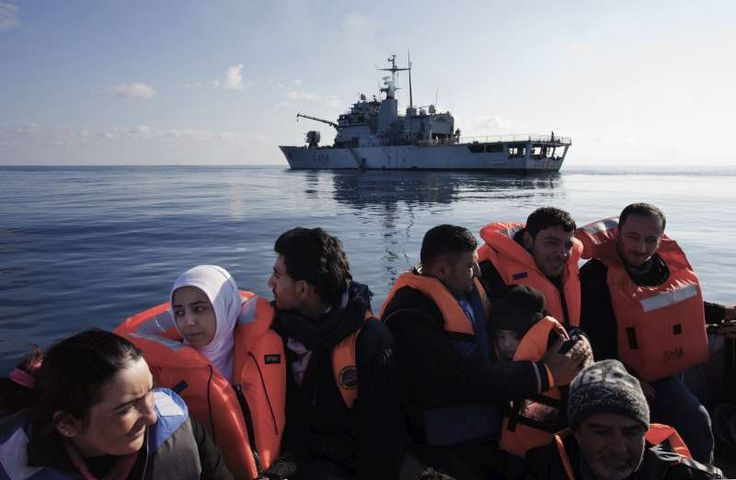 Syrian refugees are rescued in the Mediterranean Sea by crew of the Italian ship, Grecale. They will be transferred to a larger vessel, fed and given medical treatment before being transported to the mainland. ©UNHCR/A.D'Amato