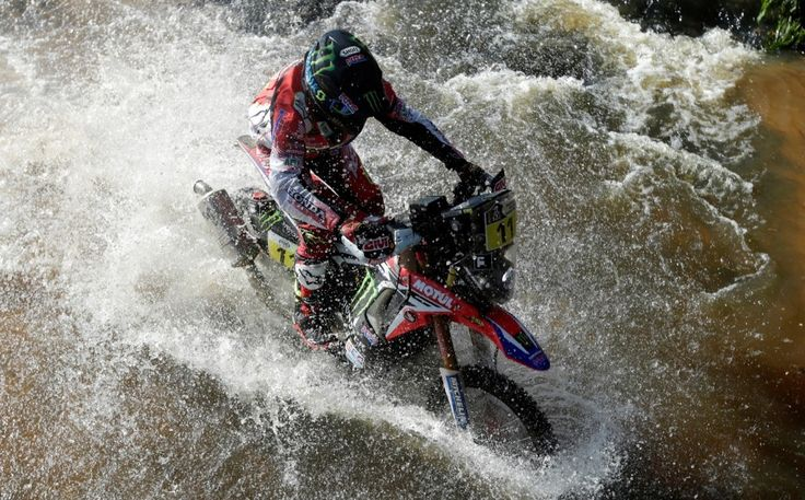 Joan Barreda of Spain rides his Honda during the first stage from Asuncion, Paraguay to Resistencia, Argentina. REUTERS/Ricardo Moraes