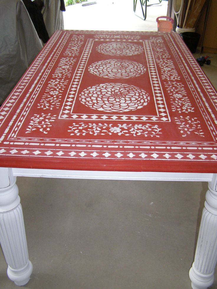 A Red And White Stenciled Kitchen Table Using The Indian