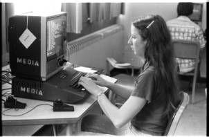 Woman at computer terminal keyboard, Ohio University math lab, 1980 :: Ohio University Archives