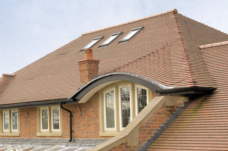 Beautiful clay roof tiles from Redland. Medium Mixed Brindle colour.