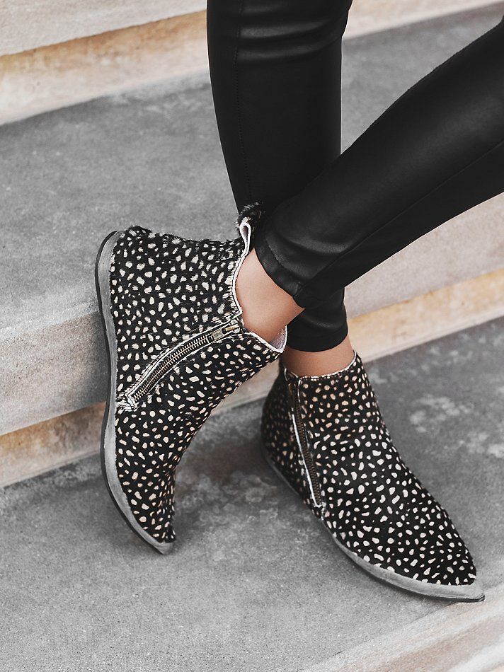 Melrose Ankle Boot | Leather ankle booties featuring an allover animal printed calf hair. Zipper accents on each side. Rubber textured sole and a slight hidden wedge.