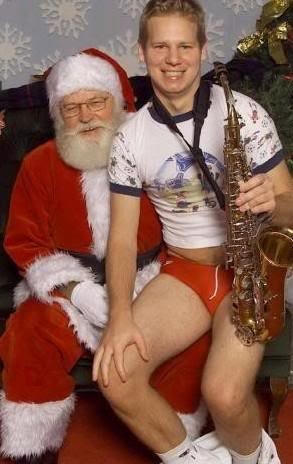 "How did this even come to happen? Who thought ""Wow, that would be an awesome Christmas photo""? How uncomfortable is Santa? How will sax-boy ever explain this to anyone, ever?"