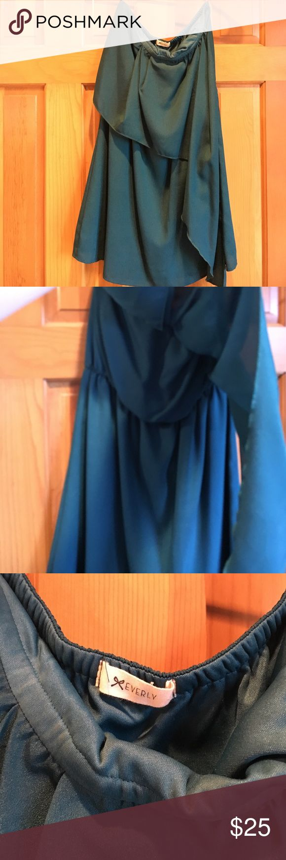 Dark teal strapless dress Dark teal strapless formal dress. Cinched at the middle with extra fabric on one side that looks like a flap on the top Everly Dresses Mini