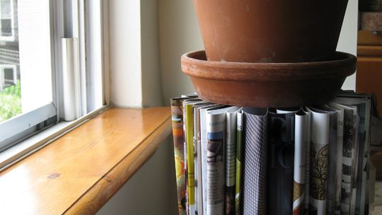 plant stand or side table out of old magazines