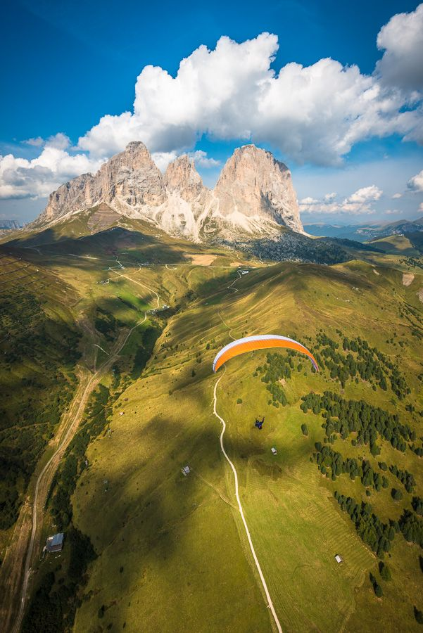 Paraglider in front of the Langkofel group of the Dolomites, Italy (by Alexandre Buisse).