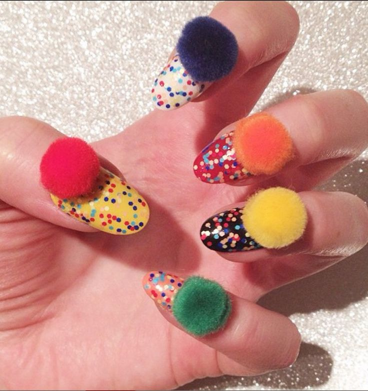 You've seen those adorably fuzzy blobs on purses everywhere lately, but there's another place you can put a pom-pom: on your nails. The nail art trend has been around in the U.S. for a minute, but it's really blowing up right now in Korea, where girls are applying them to their manis in majorly creative ways.   I'm not really sure what you can do with these puffballs on your nails, but they sure do make for a good Instagram pic.  From what I can tell, all you do to apply them is dab a little…