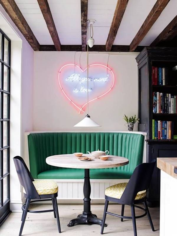 Dining nook with green booth and neon sign