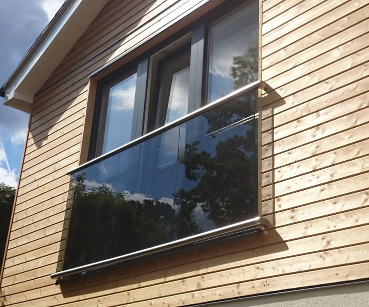 Wall flanged juliette balcony with tinted glass.  Supplied by Morris Fabrications Ltd.