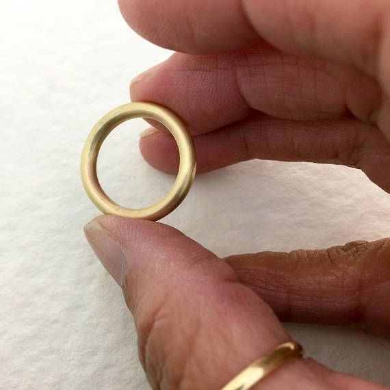 Hand forged from eco-friendly Solid Gold, this bands 3mm thick, fully-round shape presents a definite eye-catching profile. The perfect everyday ring, a beautiful addition to your stacking rings, or a modern twist on the classic wedding band for both bride and groom. BAND OPTIONS 14k or