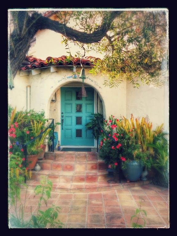 Turquoise entry door with 4 lights in 1929 California Spanish Revival home. 326 Magnolia Dr, Laguna Beach, CA