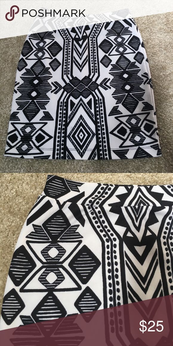 Black & White Tribal Print Mini Pencil Skirt Super comfy Renee C mini pencil skirt. Black and white tribal print. Elastic waist. Machine wash cold on gentle cycle and line dry. Worn once. Renee C. Skirts Mini