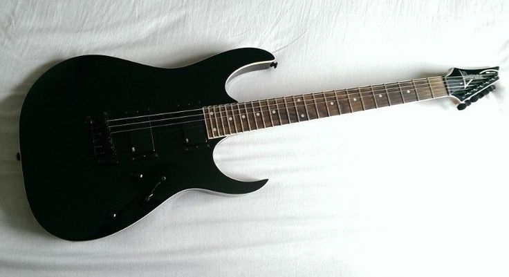 "Hi,I have an Ibanez RGR321ex looking for a new home. It forms part of Ibanez's RG series with the second ""R""referring to the reversed head-stock. Its a fixed bridge model , which stays in tune better than the tremolo system, and fairly rare in the RG series. It was made in Indonesia and a quality Ibanez guitar.  The guitar has been well looked after and is in excellent condition and finished in an awesome gloss black!The guitar is suited to the heavier rock / metal side,  but still has…"