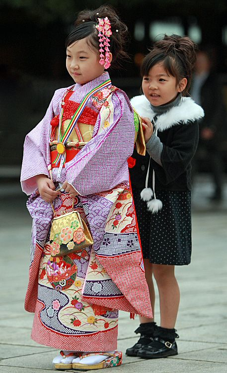 Meiji Jingu, Tokyo. Sisters at a traditional Japanese rite of passage ceremony. Girls from 3-7 and boys at age 5 go to the shrine to pray for their health and well being in kimono and hakama. These sisters were born a year apart. The elder one is 7 and this day's leading character.  The younger one's turn in the spotlight will follow a year later // photo & (paraphrased) text by Takero Kawabata, 2009