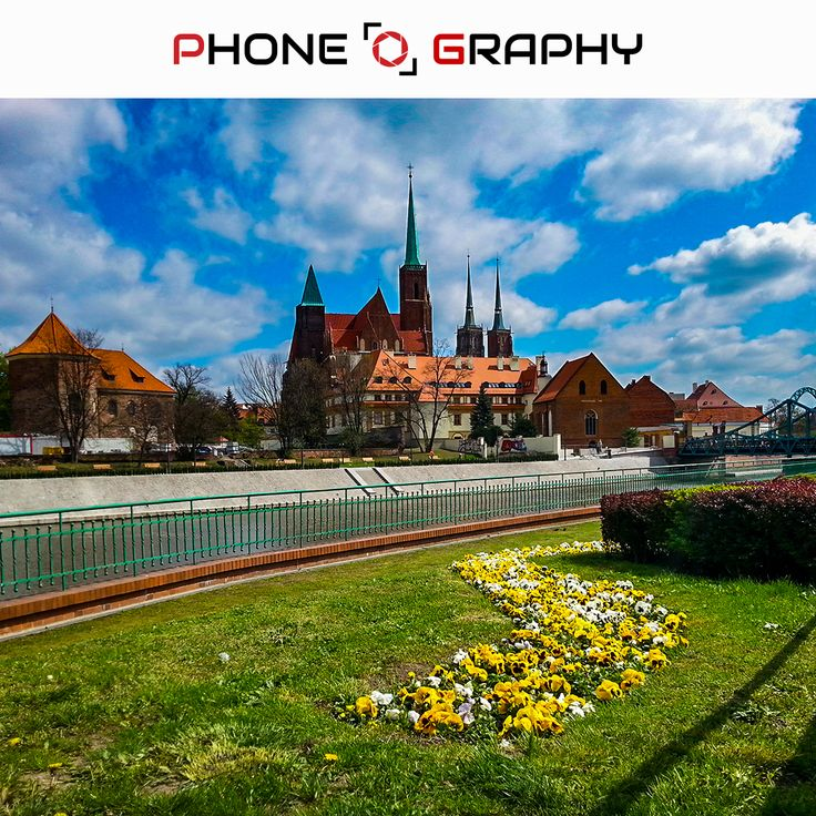 Cathedral building behid Odra River in Wroclaw Find me on Fotolia / Adobe Stock: 109053276 http://adobe.ly/pog-15  #phoneography #fotolia #instant #adobestock #igers #igerswroclaw #igerspoland #wroclaw #wroclove #miastospotkan #cathedral #katedra #building #hedge #flowers #grass #sky #bluesky #towers #odra #river #clouds #cloudyday #nofilter #photoshop #retouch #15