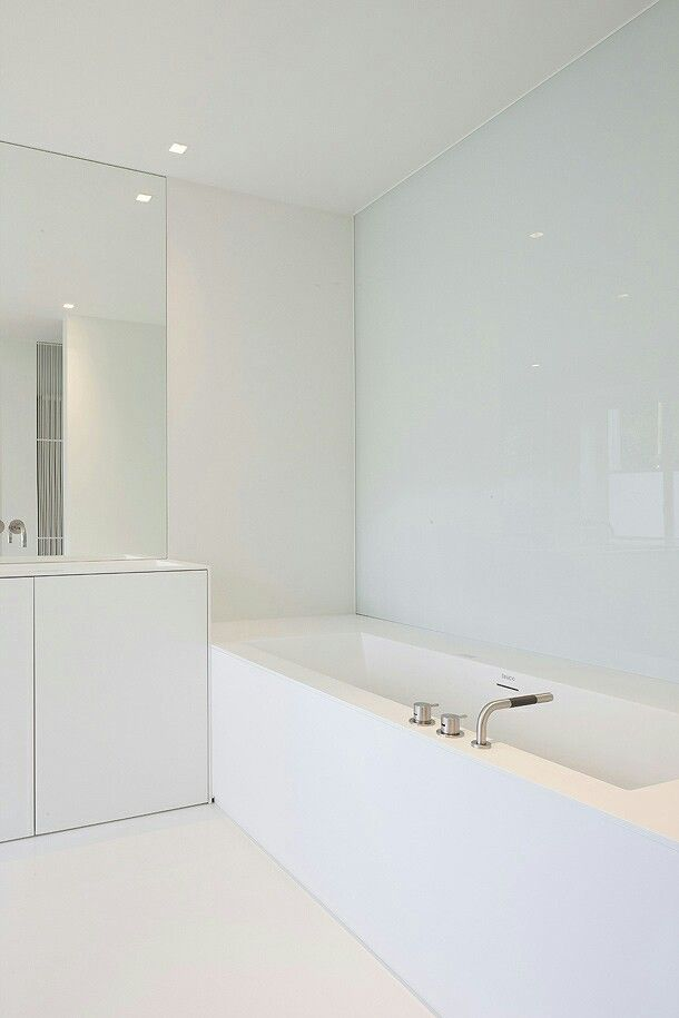All-white bathroom by Belgian architects Minus. #architecture #interiors #design #bathroom #white